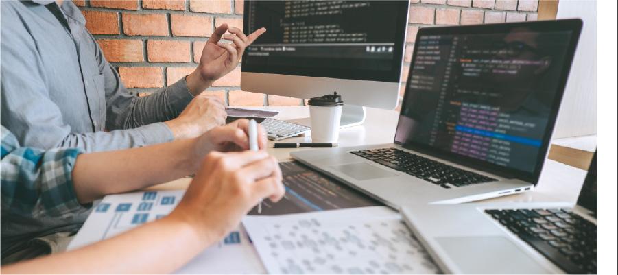 Software development team looking at code